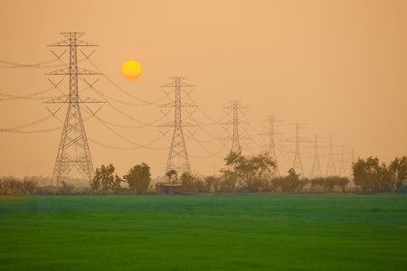 electricity grid: Electric power station in the field on sunset