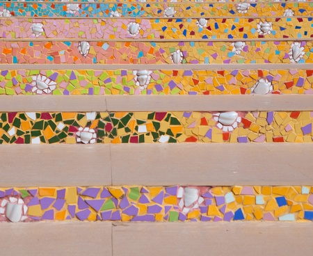 colorful pattern of stairs from broken ceramic tile photo