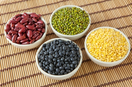 Group of beans on wood background photo
