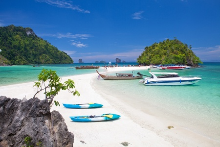 boats and the clear sea Phi Phi south of Thailand photo