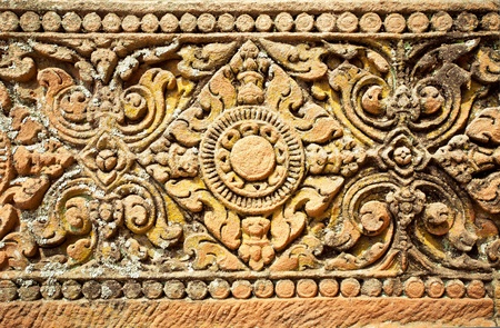 artistic flower: Old stone carvings on the wall temple in Thailand