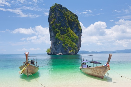 Cliff and boats and the clear sea Phi Phi Leh south of Thailand