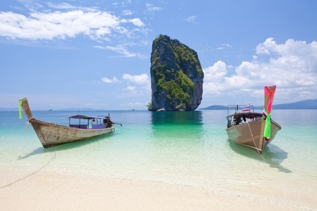 Cliff and boats in Phi Phi Leh south of Thailand photo