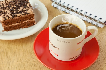 chocolate cake and coffee on wood background photo