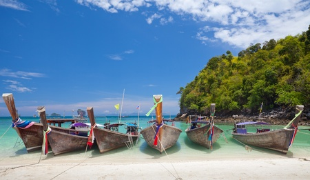 boats and the clear sea in Phi Phi Leh south of Thailand