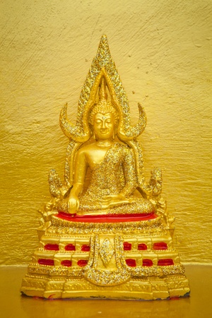 Image buddha in the gold wall background photo