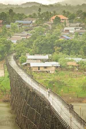 Wood bridge with river and mountain in Kanchanaburi Thailand photo
