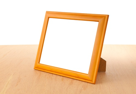 Photo frames on the table and white background