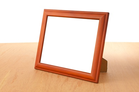 Photo frames on the table and white background photo