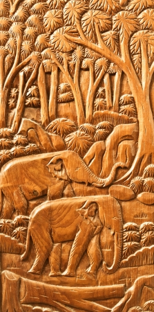 carved Thai Elephant on the wood wall photo