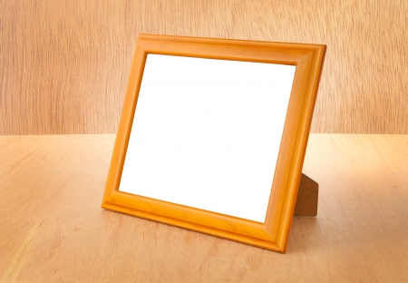 Photo frames on the table and wood background photo