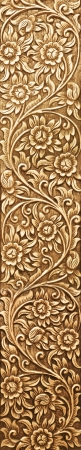 Pattern of flower carved on wood background