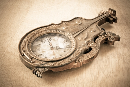 Antique gold clock on wood background photo