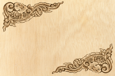 Pattern of wood frame carve flower on wood background Stock Photo - 13732821