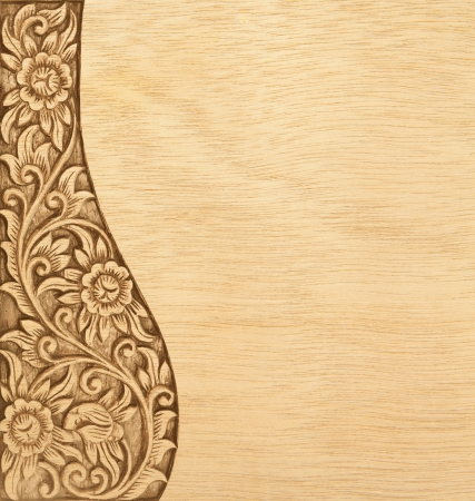 wood carving: Pattern of wood frame carve flower on wood background