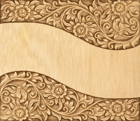 Pattern of wood frame carve flower on wood background Stock Photo - 13732825