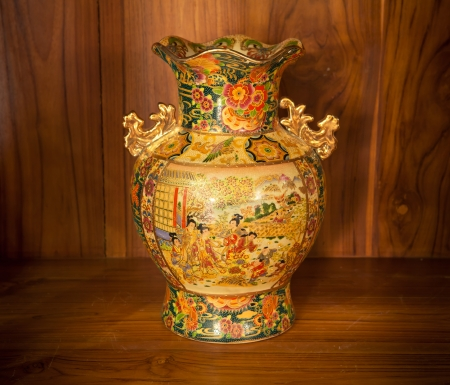 Chine vase gold on the wood background photo