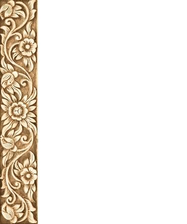 木製フレームの模様を彫る白地に花 写真素材