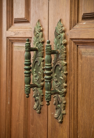 old vintage wood door handle photo
