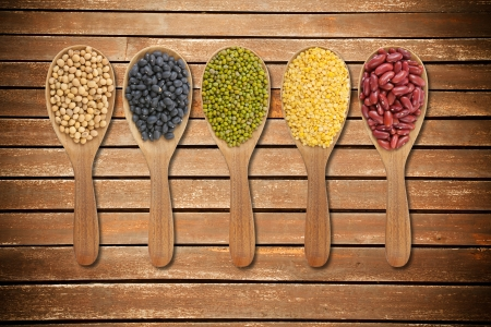 collection of beans on wooden spoons on wood Stock Photo - 14121627