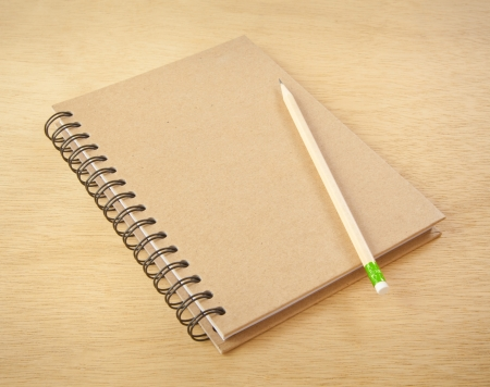 notebook cover: recycle notebook and wooden pencil on wood background