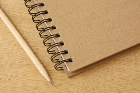 recycle notebook and wooden pencil on wood background photo