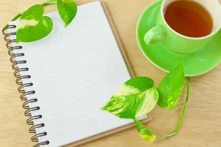recycle notebook and tea on wood background photo