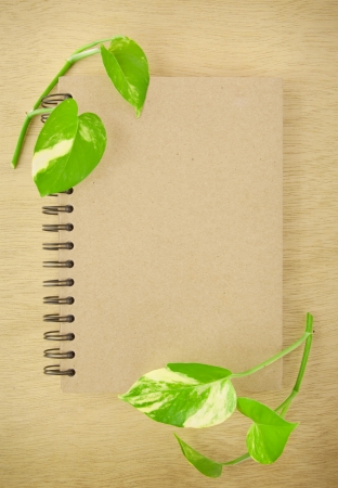 recycle notebook on wood background photo