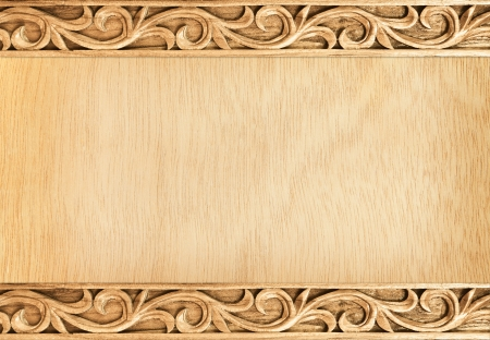 vintage timber: Pattern of flower carved frame on wood background