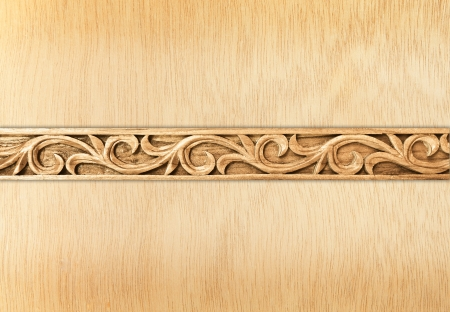 Pattern of flower carved frame on wood background photo