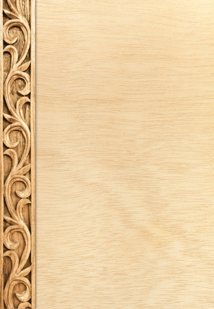 carving: Pattern of flower carved frame on wood background