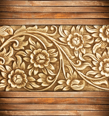 Pattern of wood frame carve flower on wood background photo
