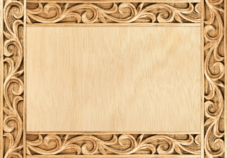 Pattern of flower carved frame on wood background Stock Photo - 14521855