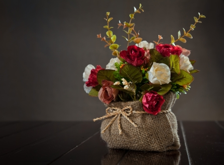 still life with rose flower on wall background photo