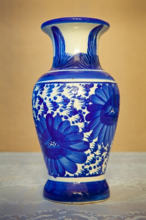 chinese antique vase on the table background photo