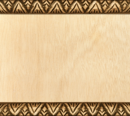 Pattern of carved frame on wood background photo