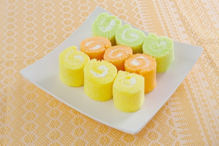 roll cake for dessert simply and freshness on orange background photo