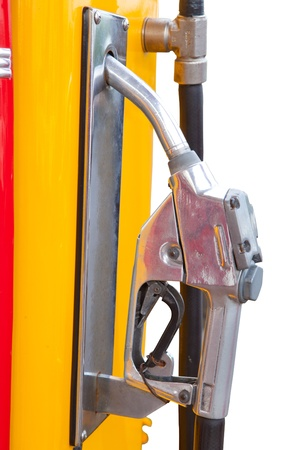 yellow vintage gasoline pump over white background photo