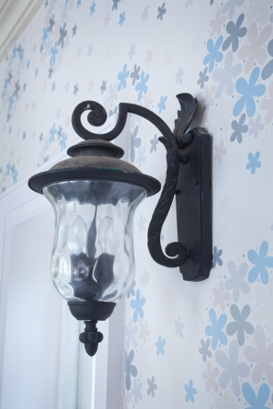 vintage wall lamp on blue wood wall photo