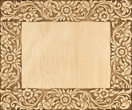 Pattern of flower carved frame on wood background Stock Photo - 15299332