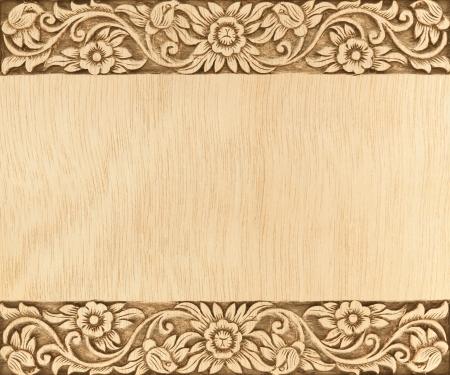 wood pattern: Pattern of flower carved frame on wood background