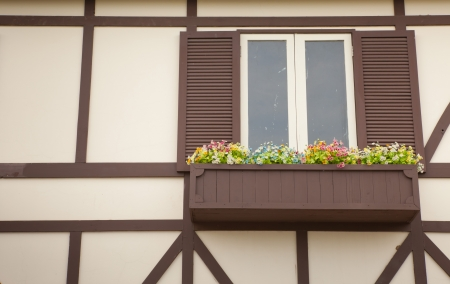 door casing: close-up wood old window and flower in brown wall Stock Photo