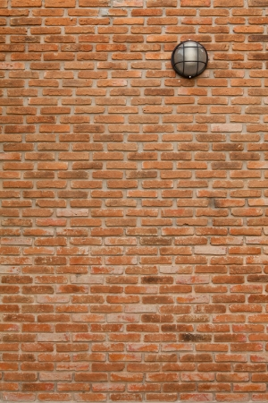 vintage wall lamp on brick wall background photo