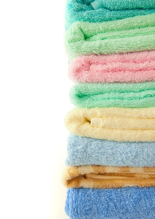 colorful towels isolated on the white background photo