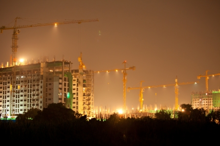 Industrial construction cranes and building at night Stock Photo - 16053699