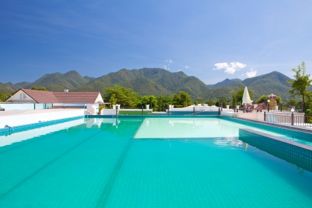 swimming pool besides mountains in Pai Maehongson ,Thailand Stock Photo - 16077229