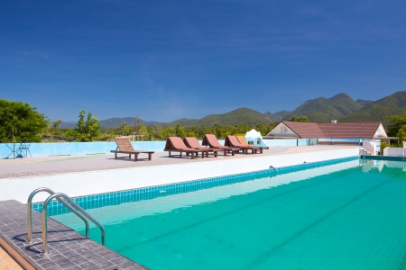 swimming pool besides mountains in Pai Maehongson ,Thailand Stock Photo - 16053760