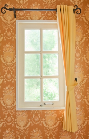 beautiful curtain on edge of a white window photo