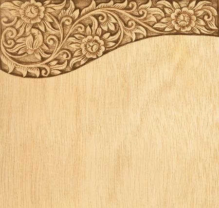 Pattern of wood frame carve flower on wood background