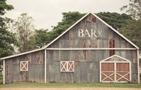 Traditional abandoned weathered barn on a farm